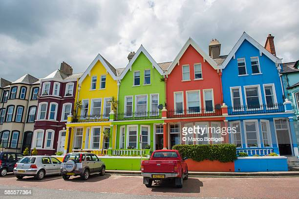 Whitehead, County Antrim, Ulster Region, Northern Ireland, United Kingdom. Colored houses on the waterfront.