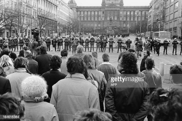 Whitehelmet Czechoslovakian riot policemen march forward in unison each holding a baton with their hands thrust forward 28 October 1988 at Wenceslas...