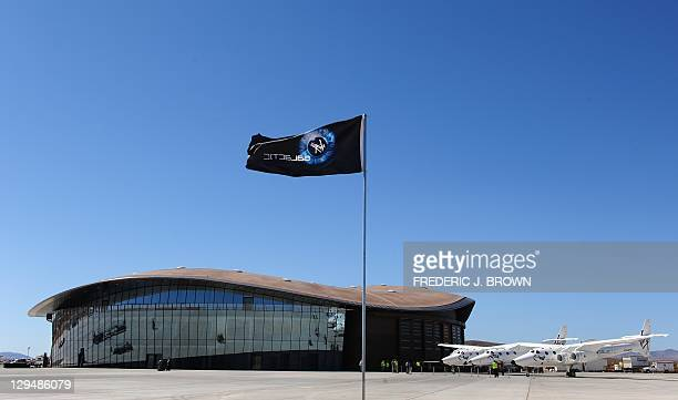 WhiteKnightTwo, carrying SpaceShipTwo, sits on display outside the Spaceport America Terminal Hangar Facility at Spaceport America northeast of Truth...