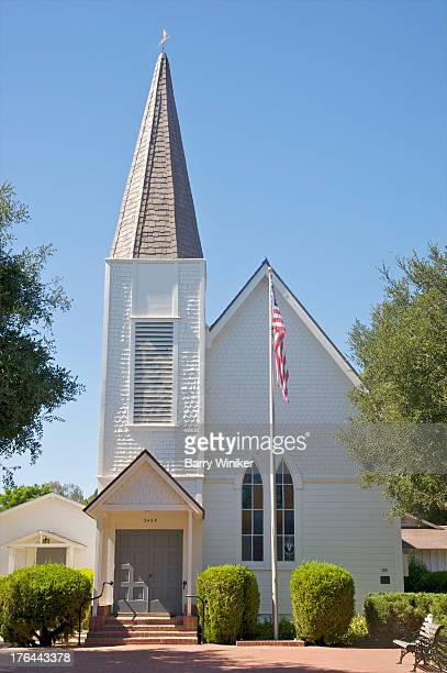White-shingled exterior of small church.