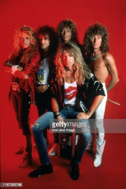 Whitesnake, the hard rock band formed in England in 1978, poses for a portrait backstage at the Joe Louis Arena while they were the opening act for...