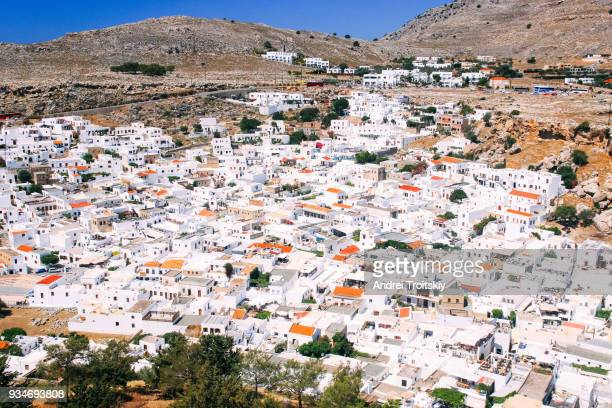 whitewashed buildings in lindos town, rhodes, greece - rhodes dodecanese islands stock photos and pictures