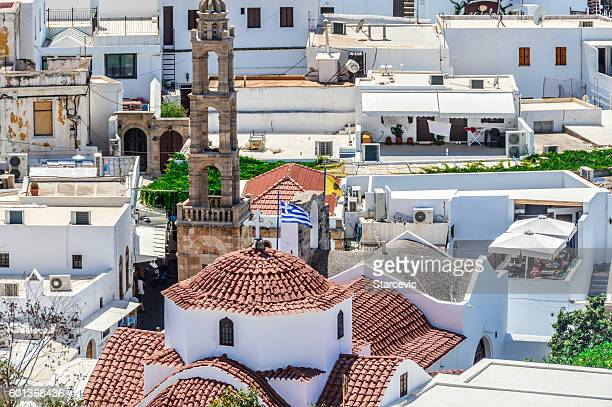 whitewashed buildings of lindos on rhodes island in greece - lindos stock photos and pictures