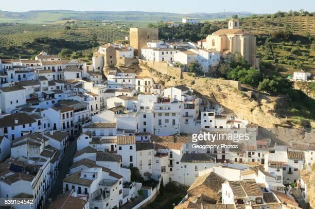 Whitewashed buildings on hillside in village of Setenil de las Bodegas Cadiz province Spain