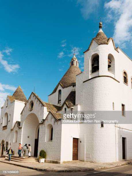 Whitewashed church with conical roofs, Alberobello, Puglia, Italy