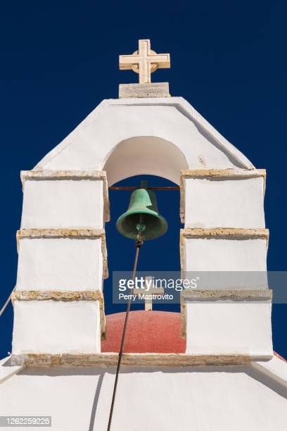 a whitewashed greek orthodox church bell tower, traditional architecture. - greek orthodoxy stock pictures, royalty-free photos & images