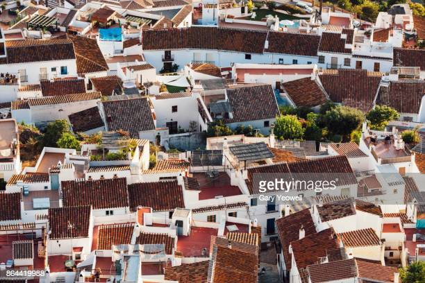 whitewashed hill town of frigiliana,spain - yeowell stock photos and pictures
