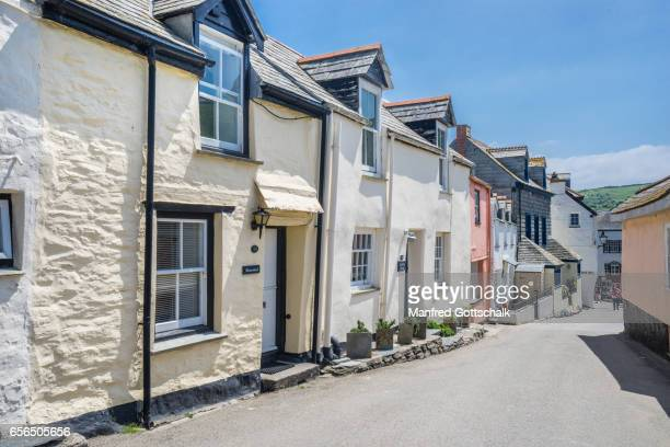 whitewashed houses port isaac cornwall - area designer label stock pictures, royalty-free photos & images