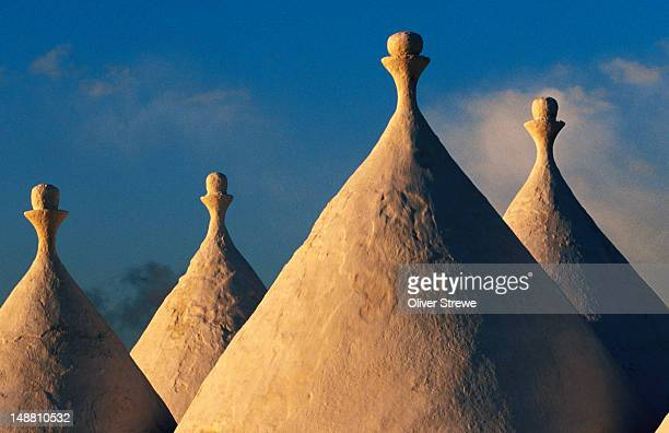 White-washed trulli roofs.