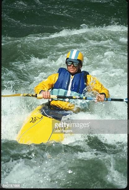Whitewater kayaker paddles over rapids on the Rogue River for a course at the Sundance Whitewater Kayaking School Oregon USA   Location Rogue River...