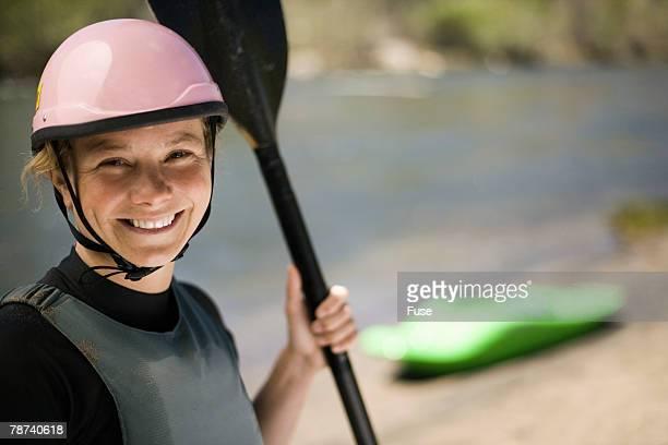 Whitewater Kayaker Standing on Riverbank