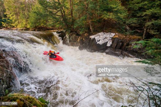 whitewater kayaking on a river in the spring - stroomversnelling stockfoto's en -beelden