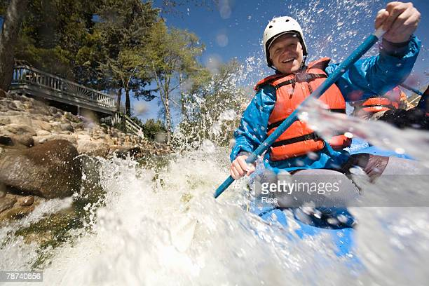 Whitewater Rafter Blasting Through Rapid