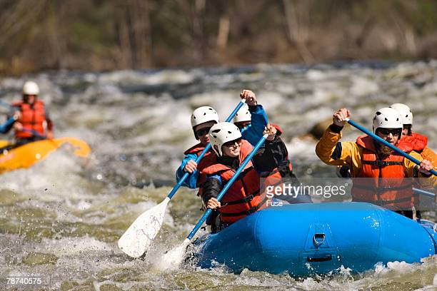 Whitewater Rafters Navigating Rapids