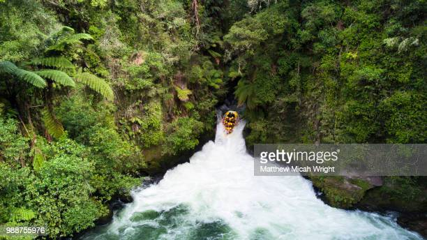 whitewater rafting down the kaituna river in rotarua. the okere falls is one of the largest commercially rafted waterfalls in the world. - inflatable raft stock pictures, royalty-free photos & images