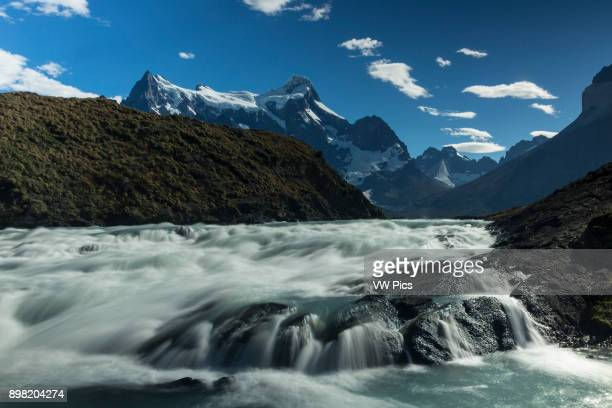 Whitewater rapids on the Rio Paine below Lake Nordenskjold Cerro Paine Grande looms in the background with the Shark's Fin and the White Throne...