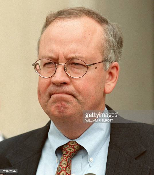 Whitewater Special Prosecutor Kenneth Starr pauses during a statement to reporters 16 April outside of the US District Courthouse in Washington DC...