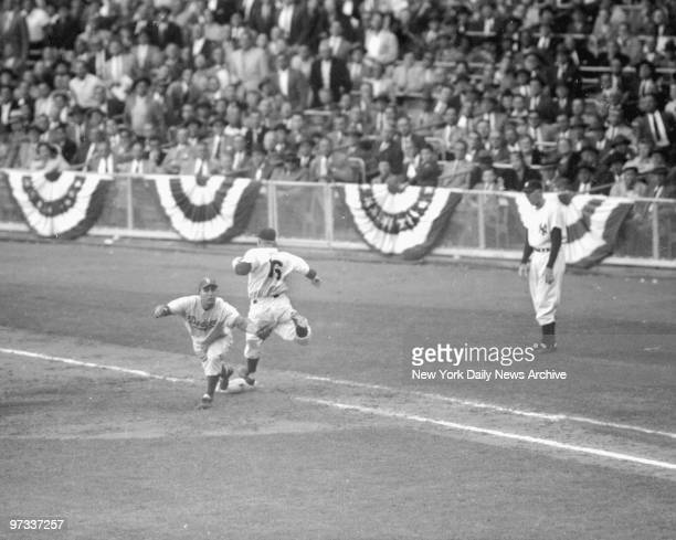 Whitey Ford of the Yankees toes first base a second too late as Gil Hodges of the Brooklyn Dodgers already holds ball in game six of the World Series