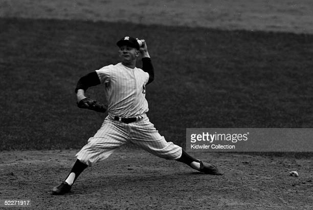Whitey Ford pitcher for the New York Yankees pitches during a World Series game on October 6 1956 against the Brooklyn Dodgers at Yankee Stadium in...