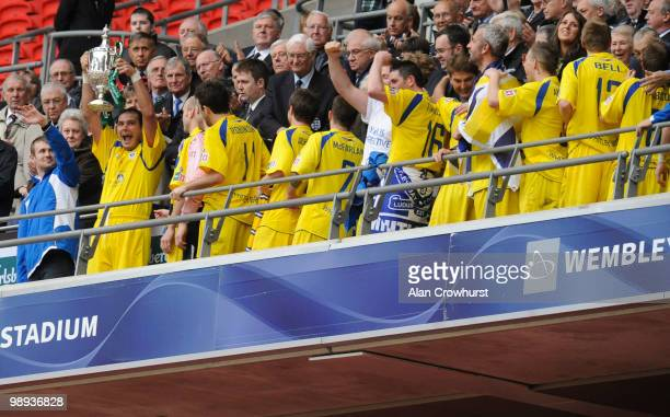 Whitley Bay's Leon Ryan lifts the trophy during the FA Carlsberg Vase Final match between Whitley Bay and Wroxham at Wembley Stadium on May 09, 2010...