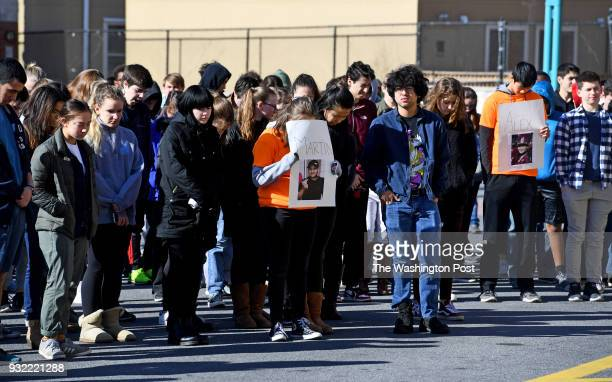 Whitman High School students hold a ceremony to honor the 17 dead from the Stoneman Douglas High shooting by reading off their names and bios and...