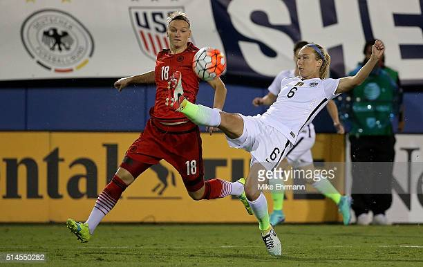 Whitney Engen of the United States and Alexandra Popp of Germany fight for the ball during a match against in the 2016 SheBelieves Cup at FAU Stadium...