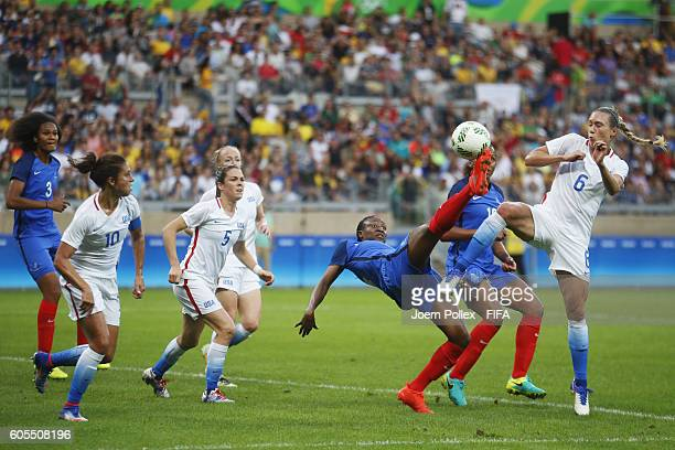 Whitney Engen of USA and Kadidiatou Diani of France compete for the ball during the Women's Group G match between USA and France on Day 1 of the...