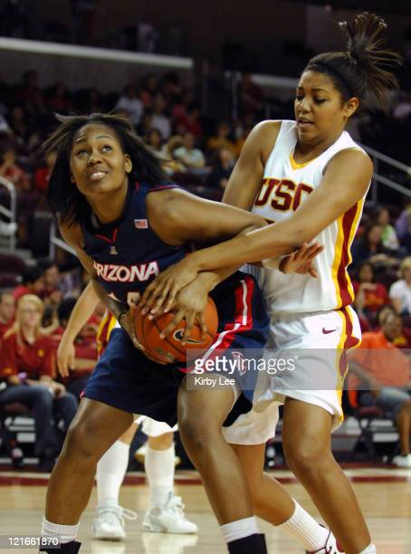 Whitney Fields of Arizona left and Aarika Hughes of USC battle for control of ball in Pacific10 Conference women's basketball game at the Galen...