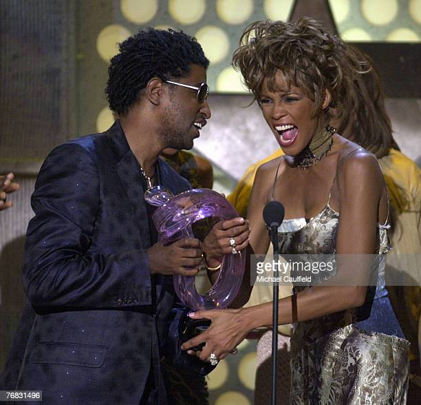 "Whitney Houston accepts Lifetime Achievement Award from Kenny ""Babyface"" Edmonds during the 1st Annual BET Awards June 19, 2001 at the Paris Hotel..."