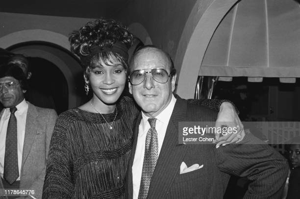 Whitney Houston and Clive Davis attend a party circa 1989