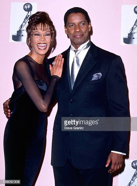 Whitney Houston and Denzel Washington pose at the NAACP Image Awards on April 6 1996 in Los Angeles California