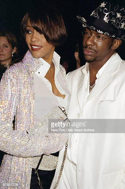 Whitney Houston and husband Bobby Brown are on hand for the Costume Institute Gala Rock Style an exhibit of rock 'n' roll fashions at the...