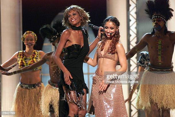 Whitney Houston and Mya performing on the Michael Jackson 30th Anniversary Celebration The Solo Years concert at New York's Madison Square Garden...