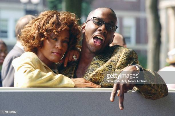 Whitney Houston is joined by her husband singer Bobby Brown at ceremonies in East Orange NJ where the Franklin School was renamed the Whitney E...