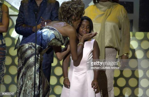 Whitney Houston kisses her daughter Bobbi Kristina Brown during the 1st Annual BET Awards June 19 2001 at the Paris Hotel and Casino in Las Vegas...