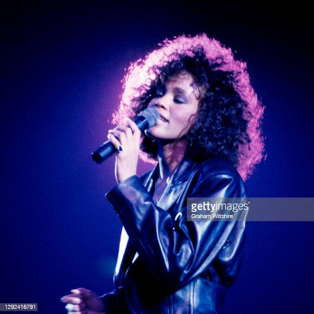 Whitney Houston performs on stage at Wembley Arena, London, on 15th May 1988.