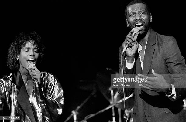 Whitney Houston performs with her half brother De Paul University basketball player Gary Garland at the Park West In in Chicago Illinois May 291985