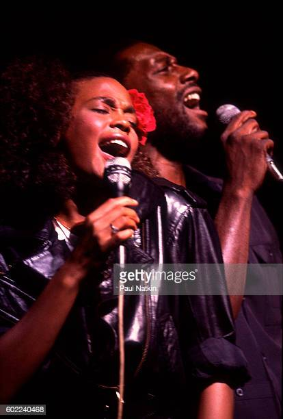Whitney Houston performs with her half brother De Paul University basketball player Gary Garland At The Poplar Creek Music Theater In Hoffman Estates...