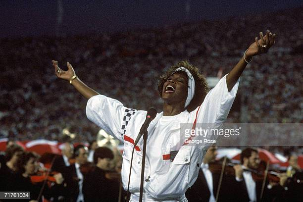Whitney Houston sings the National Anthem before a game with the New York Giants taking on the Buffalo Bills prior to Super Bowl XXV at Tampa Stadium...