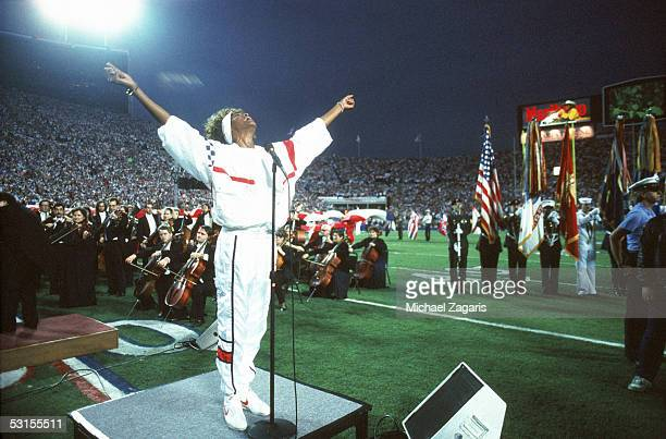 Whitney Houston sings the National Anthem before Super Bowl XXV between the New York Giants and Buffalo Bills at Tampa Stadium on January 27 1991 in...