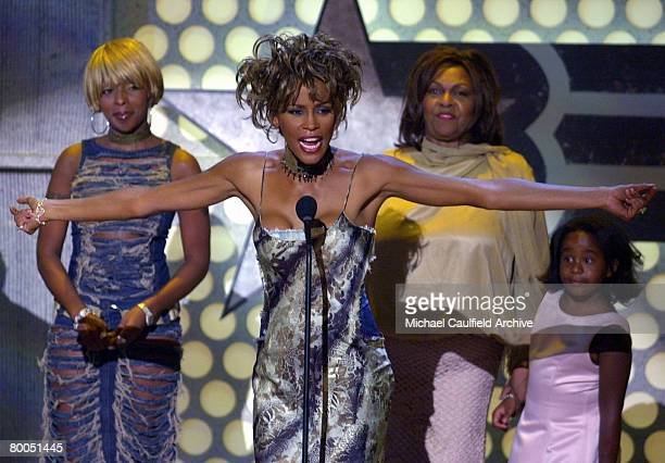 Whitney Houston speaks during her Lifetime Achievement Tribute while Mary J Blige left Cissy Houston and Bobbi Kristina Brown look on during the 1st...