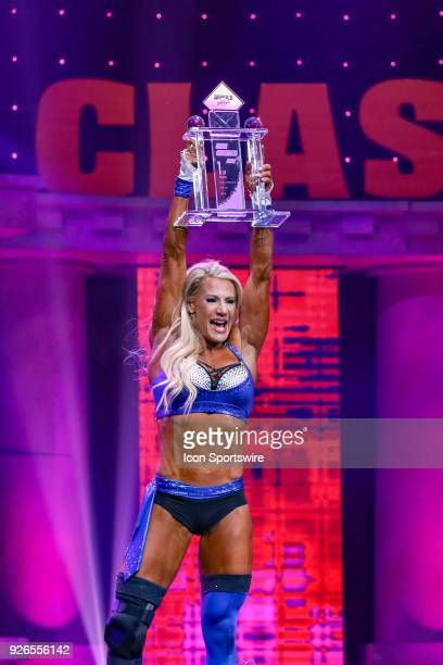 Whitney Jones raises her trophy after winning Fitness International as part of the Arnold Sports Festival on March 2 at the Greater Columbus...