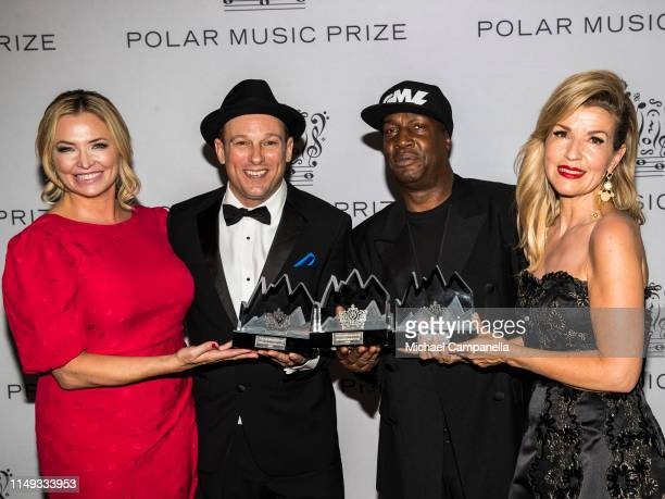 Whitney Kroenke, Mark Johnson, Grandmaster Flash, and Anne-Sophie Mutter pose with their prizes during the 2019 Polar Music Prize award ceremony on...
