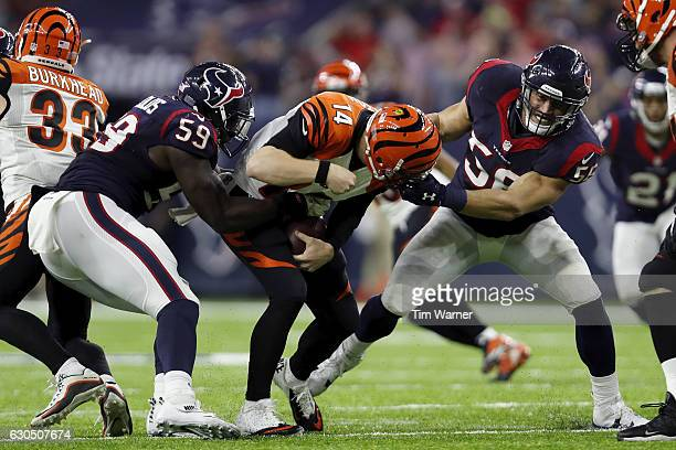 Whitney Mercilus of the Houston Texans and Brian Cushing of the Houston Texans combine to sack Andy Dalton of the Cincinnati Bengals in the fourth...