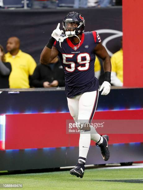 Whitney Mercilus of the Houston Texans introduced to the crowd before playing the Jacksonville Jaguars at NRG Stadium on December 30 2018 in Houston...