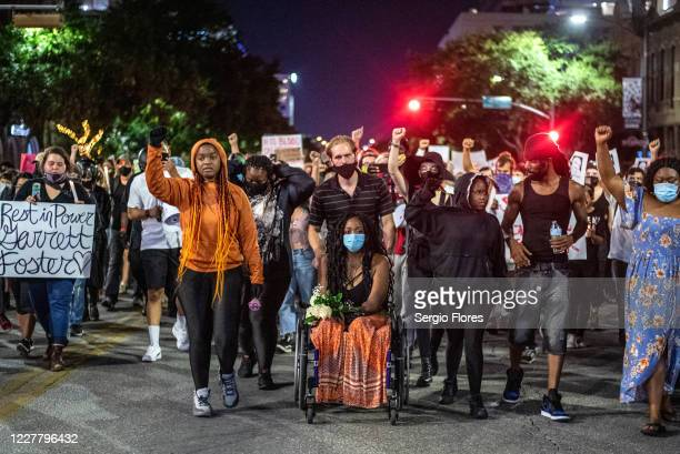 Whitney Mitchell, Garrett Foster's fiancée, attends a march for Foster on July 26, 2020 in downtown Austin, Texas. Foster who was armed and...