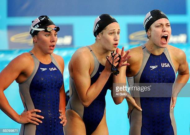 Whitney Myers Katie Hoff and Natalie Coughlin of the United States cheer during the final leg of the 4x200 meter Freestyle relay final during the XI...
