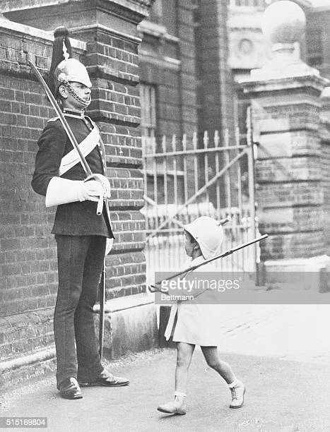 Whitney White imitates a sentry standing guard at the Knightsbridge Barracks in London. | Location: Knightbridge Barracks, London, England, UK.