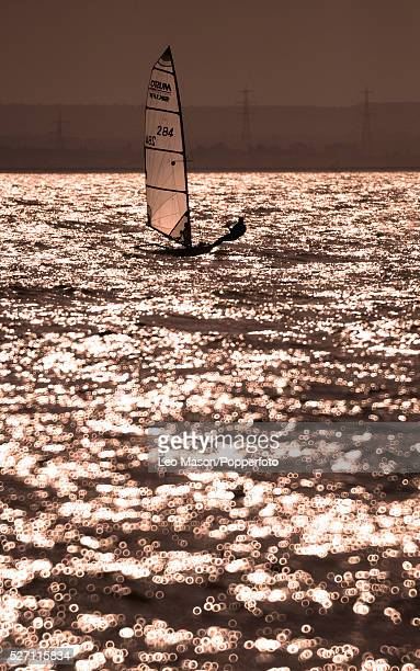 Whitstable Yacht club August Regatta Whitstable Kent Musto skiff in action at sunset | Location Whitestable England United Kingdom