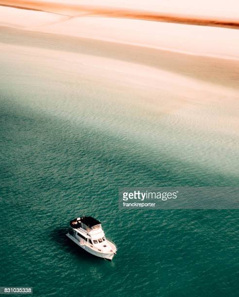 whitsunday beach with a boat